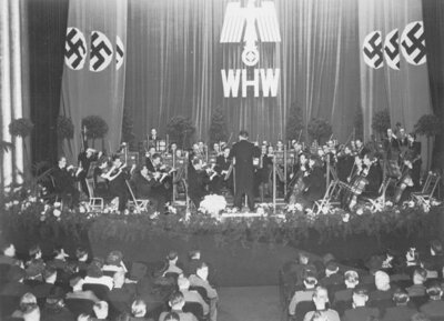 Concert for the benefit of 'Winterhulp', the Dutch counterpart to Winterhilfswerk in Germany (source: NIOD/WWII Image Bank)